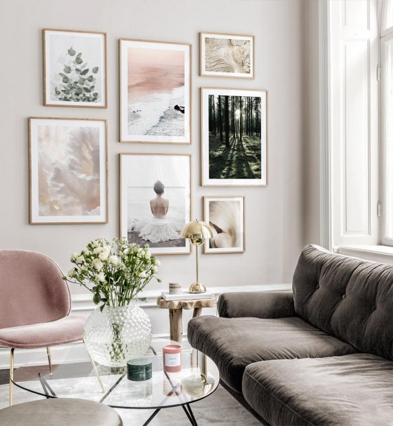 Stylish gallery wall with naturemotifs and oak frames