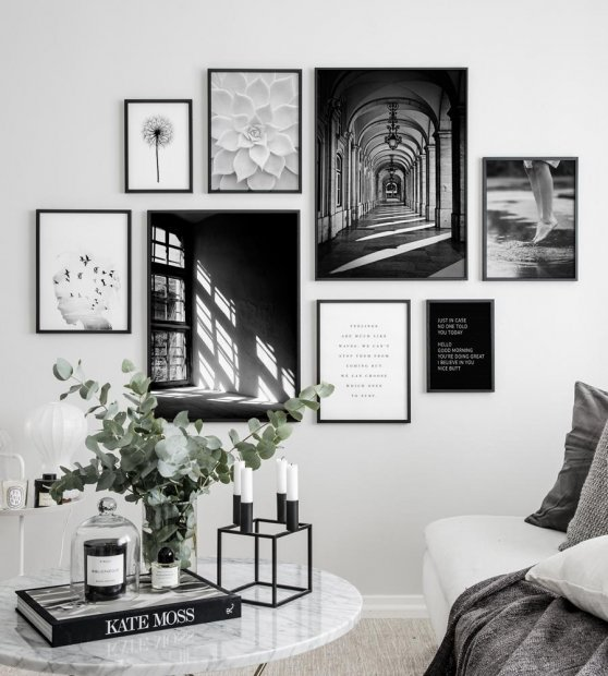 Gallery wall with black frames and black and white posters