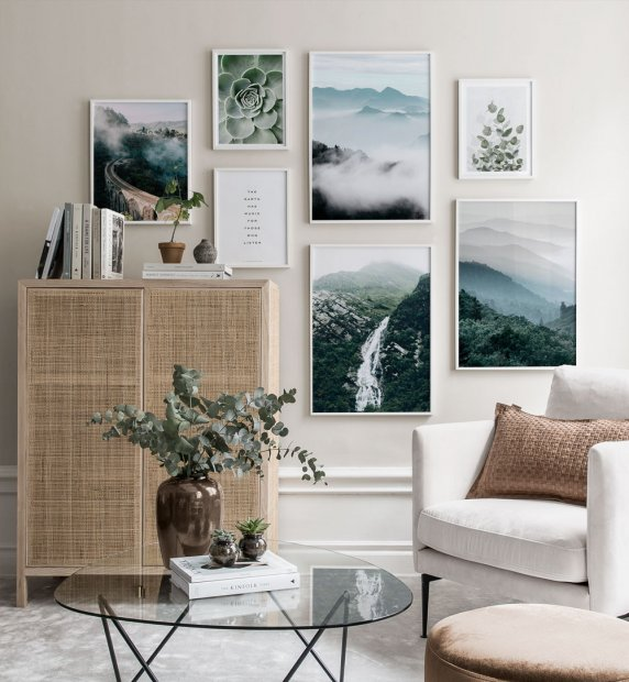 Elegant gallery wall in earthy colours with white wooden frames