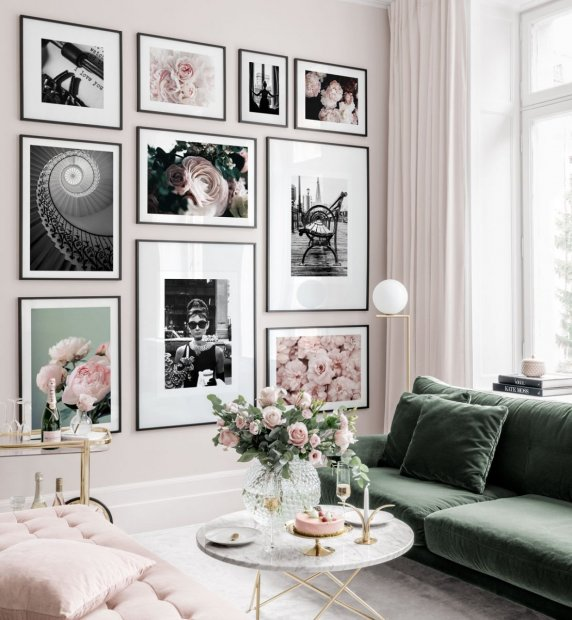 Beautiful gallery wall in pink shades with black and white posters and flowers