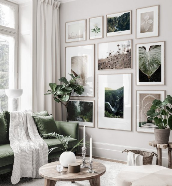 Soothing gallery wall in brown green tones with nature posters in oaken frames